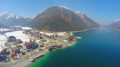 Aerial view of lakeside hotel at mountain bottom, nature, tourism, recreation Stock Footage