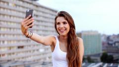 Attractive Young Woman Taking A Selfie On Her Smart Phone Stock Footage