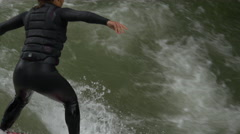 Surfing on the river in the English Garden of Munich, Germany Stock Footage