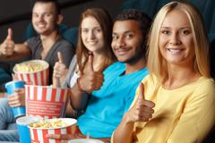 Thumbs up for impressive film - stock photo