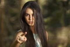 Closeup portrait of young angry woman pointing at someone as if to say you di Stock Photos