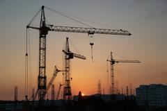 Industrial cranes - stock photo