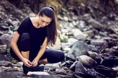Young Asian woman hiker by the river, outdoors activities - stock photo
