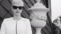 Beautiful sexy blond business women wearing sunglasses white jacket Stock Footage