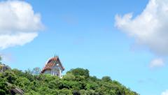 Time Lapse Movie of cloud movement over Buddhist chapel on Mountain Stock Footage