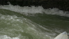 Surfing on Isar River, in the English Garden of Munich, Germany - stock footage