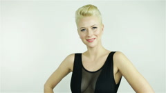 Beautiful young blonde girl with short hair - stock footage