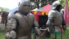 4k Knight's armor at medieval pageant event with tents Stock Footage
