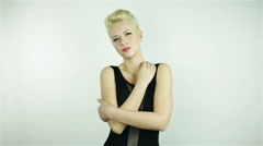 Beautiful young blonde girl with short hair Stock Footage
