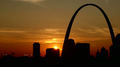 Beautiful golden St. Louis Arch sunset time lapse Stock Footage