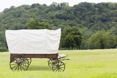Covered wagon in fields Stock Photos