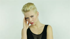 Stock Video Footage of Beautiful young blonde girl with short hair
