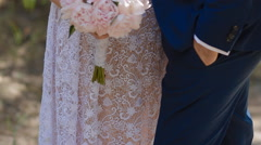 Bride hold bouquet of pink peones Stock Footage