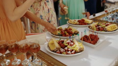 People eat fruits on the party outdoor Stock Footage