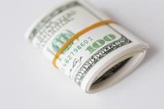 Stock Photo of close up of dollar money packet tied with rubber
