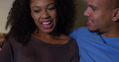 An affectionate young couple using a digital tablet at home. Shot on RED Epic. Stock Footage