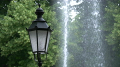 Old lamppost near a fountain in Munich Stock Footage