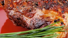 Savory plate : roasted meat shoulder on red Stock Footage
