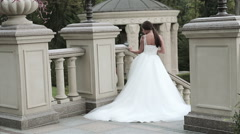 Beautiful young woman sexy brunette bride in a luxury Stock Footage