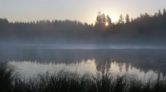 Timelapse shot of fog moving at a lake in early morning Stock Footage