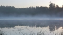 Foggy lake in early morning Stock Footage