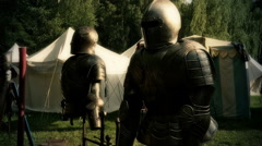 Knight's armor dolly FX at medieval pageant event Stock Footage