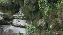 Raining on the Isar River's rocks in Munich Stock Footage