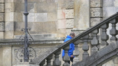 Man going up the stairs at Friedensengel in Munich Stock Footage