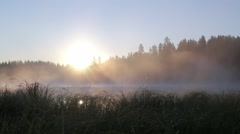 Locked-down shot of fog moving at a lake during sunset Stock Footage