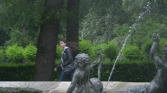 Girl walking near the Friedensengel's fountain in Munich Stock Footage