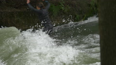 View of a man surfing on Isar River, Munich - stock footage