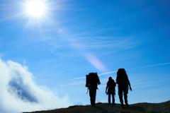 Silhouette of hiking friends - stock photo