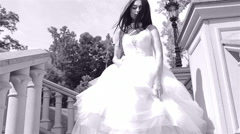 Stairs beautiful young woman sexy brunette bride in a luxury Stock Footage