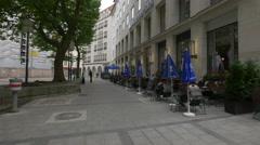 Interior courtyard with restaurants in Munich Stock Footage