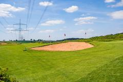 Sand bunker, golf course - stock photo