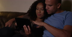 A young African American couple doing some online shopping at home. Stock Footage