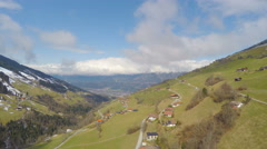 Beautiful aerial view of mountain landscape, small Alpine village, green tourism Stock Footage