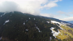 Austrian Alps, thick clouds over mountain peak, high humidity, weather Stock Footage