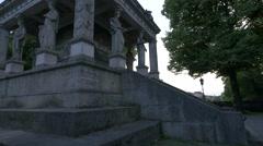 Relaxing near the Friedensengel pillar statues in Munich Stock Footage
