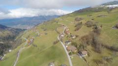 Aerial view, nice cottages on picturesque mountain slope, downshifting, tourism Stock Footage