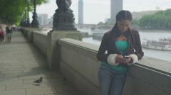 4K Portrait of beautiful smiling woman with mobile phone in London Stock Footage