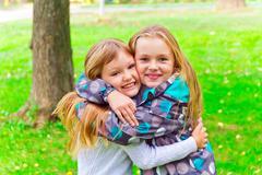 Cute two embracing girls Stock Photos