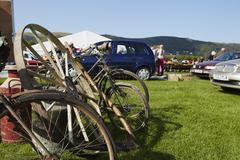 Selection of vintage bicycles wheel rim and an old milk churn for sale at a flea Stock Photos