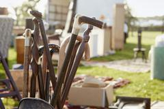 Selection of wooden canes and walking sticks for sale at an open air flea market - stock photo