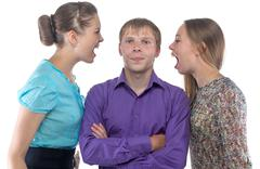 Man and two screaming women Stock Photos