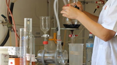 Woman do tests in a winery laboratory  Stock Footage