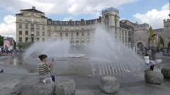 Adults and children in Karlsplatz, Munich Stock Footage