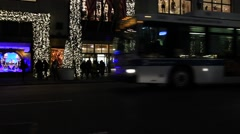 Buses Passing Christmas Decorated Store Night Stock Footage