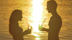 5 in 1 video!Pair stand on the beach by sunlight reflection on the water surface Stock Footage