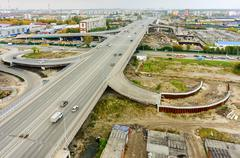Aerial view of highway interchange of modern urban city - stock photo